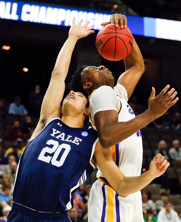 . Yale \'s Paul Atkinson (20) and LSU\'s Kavell Bigby-Williams battle for a rebound during the first half of a first round men\'s college basketball game in the NCAA Tournament in Jacksonville, Fla. Thursday, March 21, 2019. (AP Photo/Stephen B. Morton)