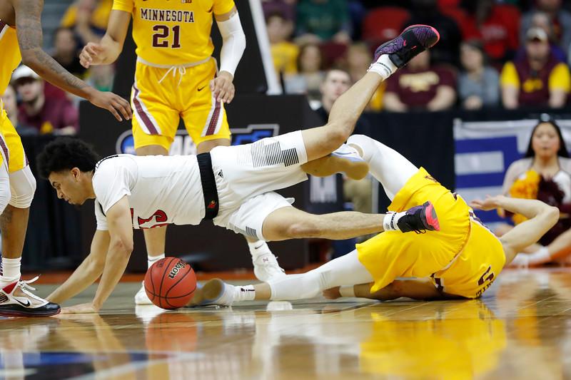 APTOPIX NCAA Minnesota Louisville Basketball