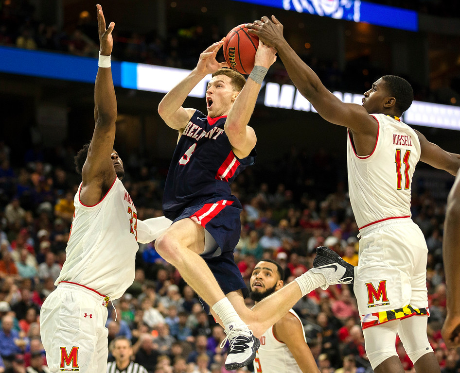 . Belmont \'s Dylan Windler, center, goes to the basket between Maryland \'s Bruno Fernando, left, and Darryl Morsell (11) during the second half of the first round men\'s college basketball game in the NCAA Tournament in Jacksonville, Fla. Thursday, March 21, 2019. (AP Photo/Stephen B. Morton)