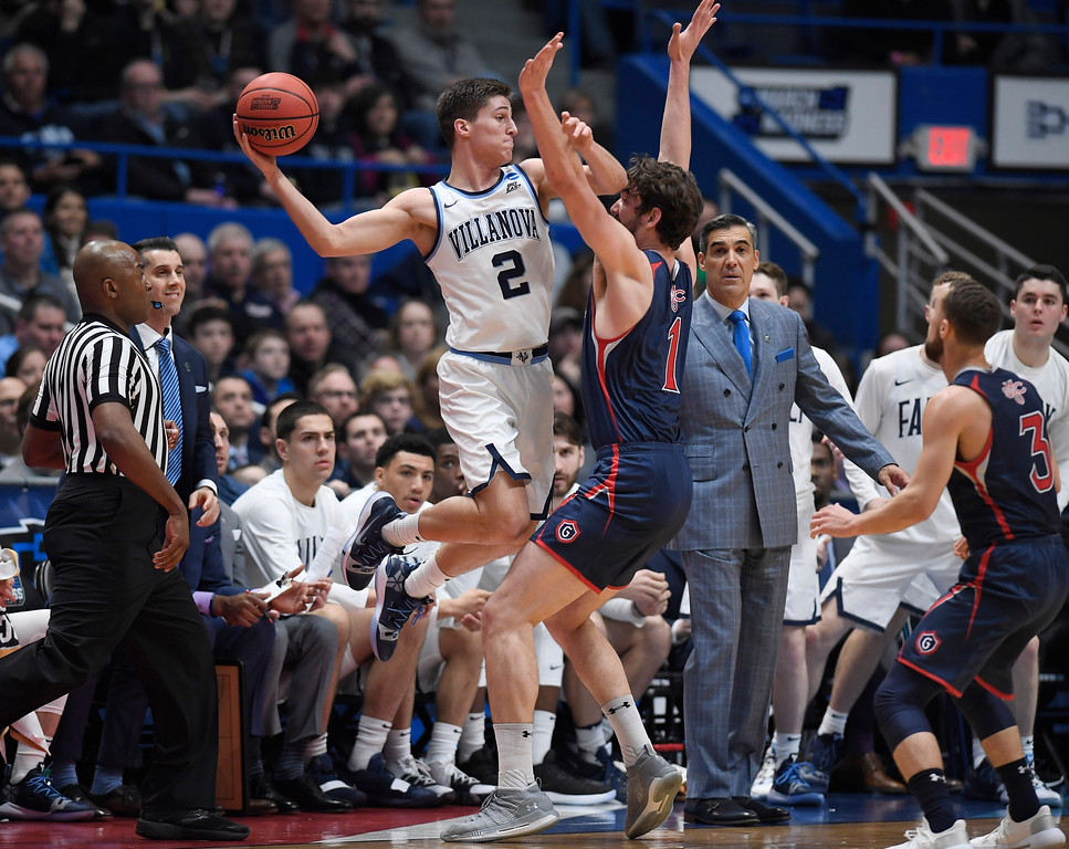 . Villanova\'s Collin Gillespie (2) passes before falling out of bounds while St. Mary\'s Jordan Hunter (1) defends during the first half of a first round men\'s college basketball game in the NCAA tournament, Thursday, March 21, 2019, in Hartford, Conn. (AP Photo/Jessica Hill)