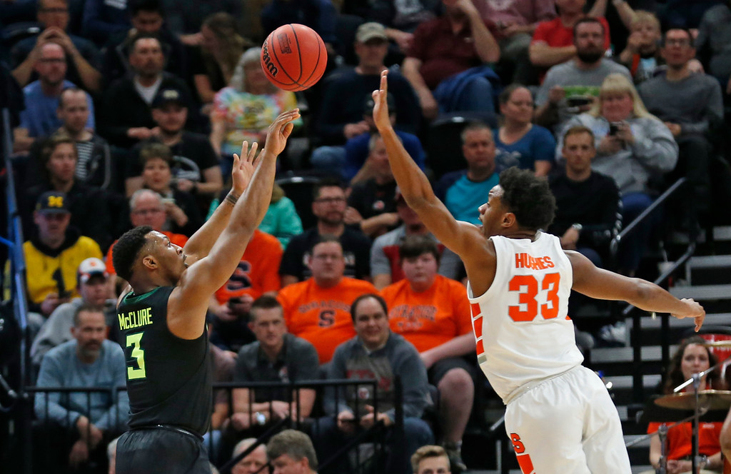 . Baylor guard King McClure (3) shoots as Syracuse forward Elijah Hughes (33) defends during the first half of a first-round game in the NCAA men�s college basketball tournament Thursday, March 21, 2019, in Salt Lake City. (AP Photo/Rick Bowmer)