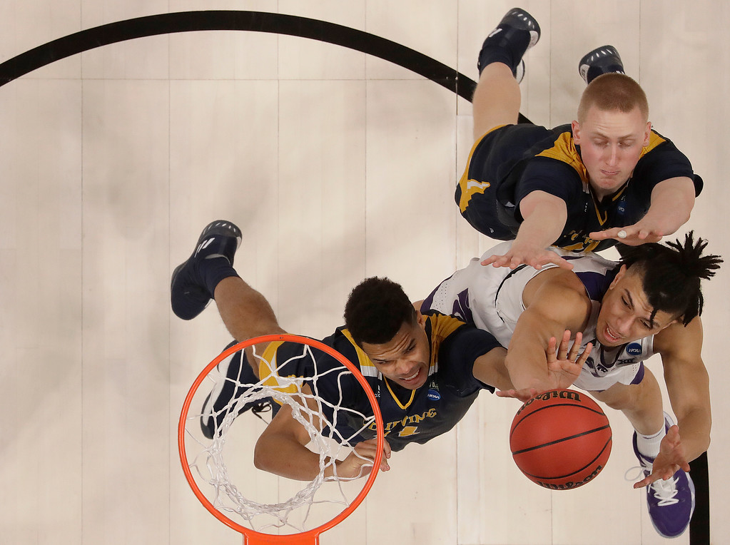 . Kansas State guard Mike McGuirl, bottom right, shoots against UC Irvine guard Evan Leonard, left, and UC Irvine forward Collin Welp during the second half of a first round men\'s college basketball game in the NCAA Tournament Friday, March 22, 2019, in San Jose, Calif. (AP Photo/Ben Margot)