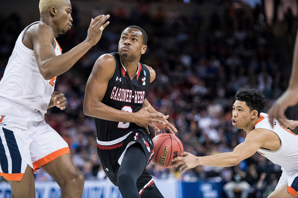 . Gardner Webb forward Eric Jamison Jr. (2) has the stripped by Virginia guard Kihei Clark, right, during a first-round game in the NCAA men�s college basketball tournament Friday, March 22, 2019, in Columbia, S.C. Virginia defeated Gardner-Webb 71-56. (AP Photo/Sean Rayford)