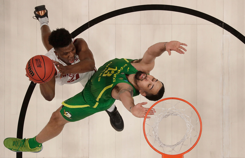 . Wisconsin guard Khalil Iverson, left, shoots against Oregon forward Paul White during the first half of a first round men\'s college basketball game in the NCAA Tournament, Friday, March 22, 2019, in San Jose, Calif. (AP Photo/Ben Margot)