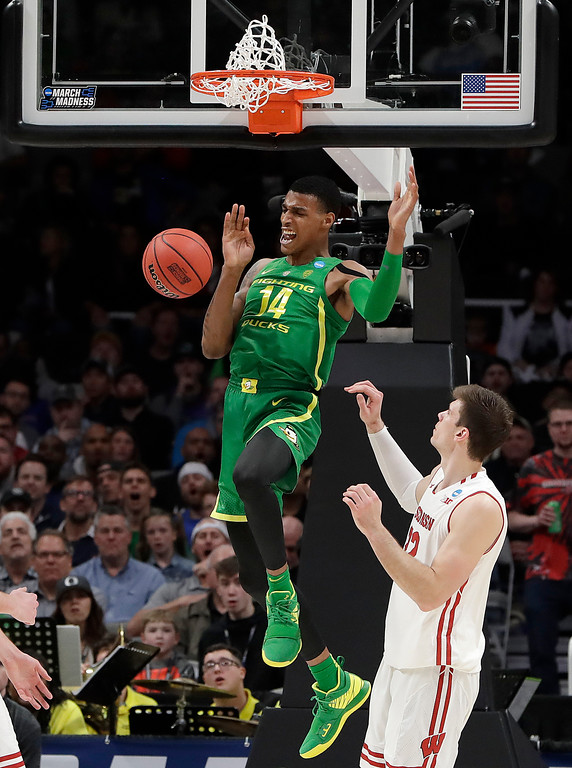 . Oregon forward Kenny Wooten (14) reacts after dunking over Wisconsin forward Ethan Happ during the second half of a first-round game in the NCAA men�s college basketball tournament, Friday, March 22, 2019, in San Jose, Calif. (AP Photo/Chris Carlson)