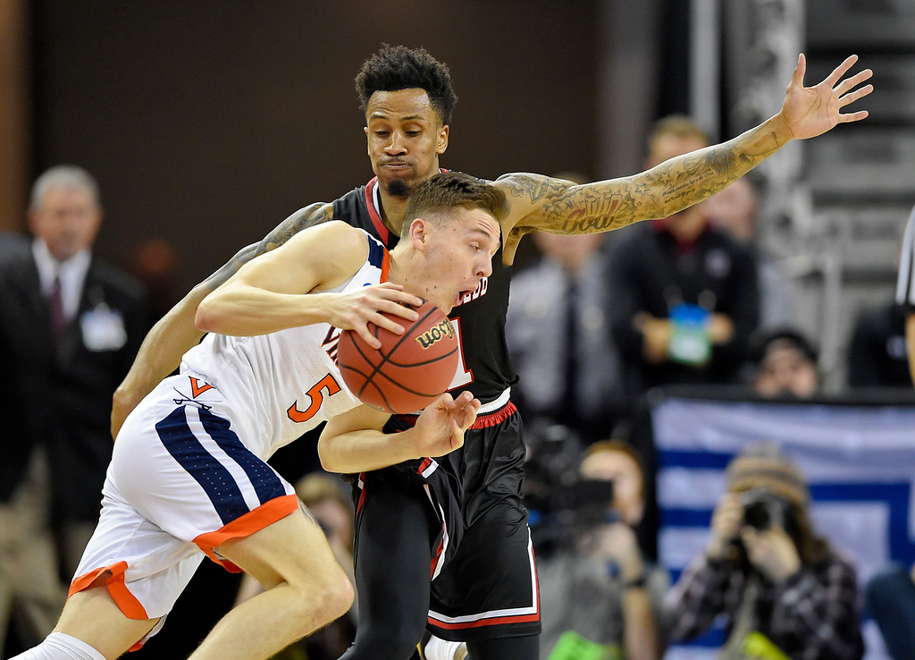 . Virginia\'s Kyle Guy (5) drives against Gardner-Webb\'s David Efianayi (11) during a first-round game in the NCAA men�s college basketball tournament in Columbia, S.C., Friday, March 22, 2019. (AP Photo/Richard Shiro)
