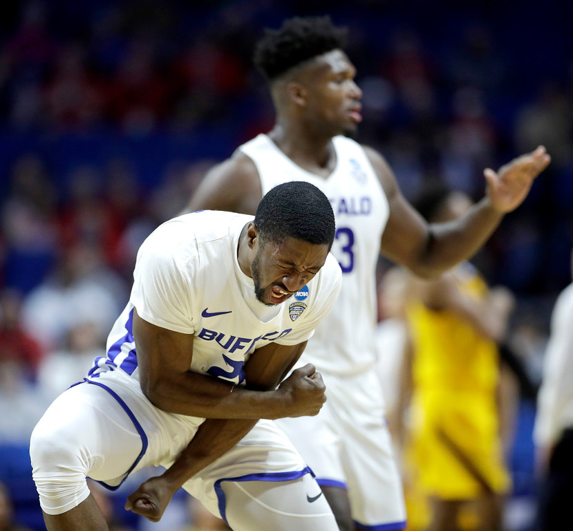 . Buffalo\'s Dontay Caruthers celebrates a teammates basket during the first half of a first round men\'s college basketball game against Arizona in the NCAA Tournament Friday, March 22, 2019, in Tulsa, Okla. (AP Photo/Charlie Riedel)