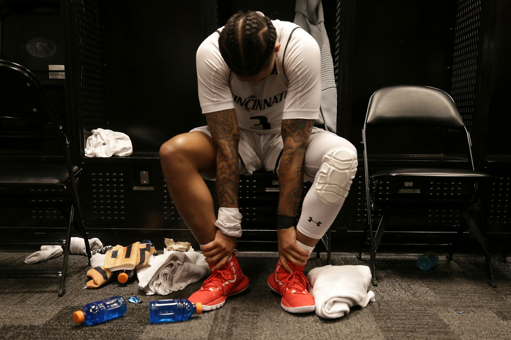 . Cincinnati guard Justin Jenifer (3) reacts in the locker room after a first-round game against Iowa in the NCAA men�s college basketball tournament, Friday, March 22, 2019, in Columbus, Ohio. Iowa won 79-72. (Kareem Elgazzar/The Cincinnati Enquirer via AP)