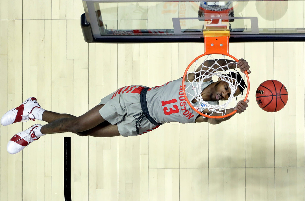 . Houston\'s DeJon Jarreau dunks the ball during the first half of a first round men\'s college basketball game against Georgia State in the NCAA Tournament Friday, March 22, 2019, in Tulsa, Okla. (AP Photo/Jeff Roberson)