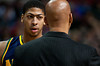 Feb 11, 2013; Auburn Hills, MI, USA; New Orleans Hornets power forward Anthony Davis (left) listens to New Orleans Hornets head coach Monty Williams (right) during the first quarter against the Detroit Pistons at The Palace. Mandatory Credit: Tim Fuller-USA TODAY Sports