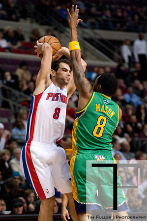 Feb 11, 2013; Auburn Hills, MI, USA; Detroit Pistons point guard Jose Calderon (8) passes over New Orleans Hornets shooting guard Roger Mason Jr. (8) during the first quarter at The Palace. Mandatory Credit: Tim Fuller-USA TODAY Sports