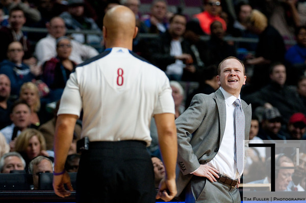 Feb 11, 2013; Auburn Hills, MI, USA; Detroit Pistons head coach Lawrence Frank argues with referee Marc Davis (8) during the first quarter against the New Orleans Hornets at The Palace. Mandatory Credit: Tim Fuller-USA TODAY Sports