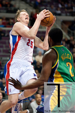 Feb 11, 2013; Auburn Hills, MI, USA; Detroit Pistons shooting guard Kyle Singler (25) goes to the basket New Orleans Hornets small forward Darius Miller (2) during the second quarter at The Palace. Mandatory Credit: Tim Fuller-USA TODAY Sports