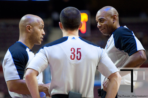Feb 11, 2013; Auburn Hills, MI, USA; NBA referees Marc Davis (left) Kane Fitzgerald (35) and Karl Lane (right) talk during the game between the Detroit Pistons and the New Orleans Hornets at The Palace. Hornets won 105-86. Mandatory Credit: Tim Fuller-USA TODAY Sports