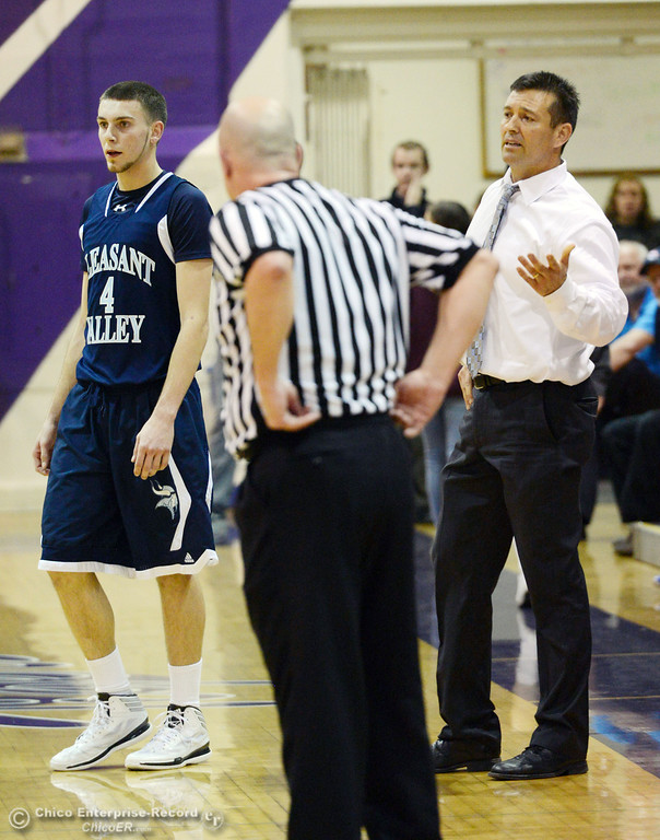 . Pleasant Valley High\'s #4 Jerry Migasi (left) received a technical as coach Tim Keating (right) questions the call in the fourth quarter of their boys basketball game at OHS Wednesday, February 19, 2014 in Oroville, Calif.  (Jason Halley/Chico Enterprise-Record)