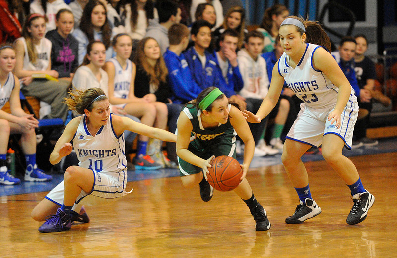 Oakmont's Skylar Alves picks up a loose ball by Lunenburg's Hannah Keohan (left) and Gabby Masciarelli, Friday.<br /> SENTINEL & ENTERPRISE / BRETT CRAWFORD