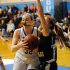 Lunenburg's Sami Day puts looks to pass while guarded by Oakmont's Haley Maciel, Friday.<br /> SENTINEL & ENTERPRISE / BRETT CRAWFORD