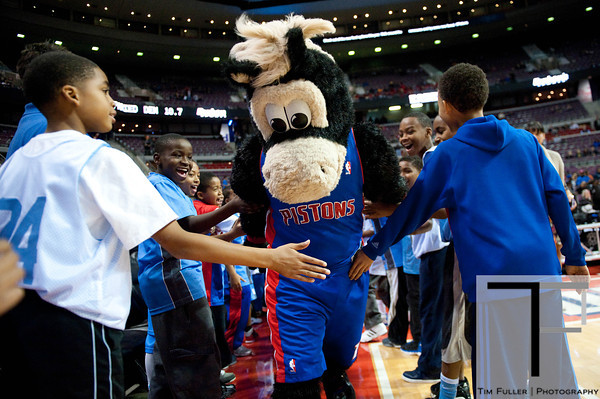 Nov 12, 2012; Auburn Hills, MI, USA; Detroit Pistons mascot Hooper high fives fans before the game against the Oklahoma City Thunder at The Palace. Mandatory Credit: Tim Fuller-US PRESSWIRE
