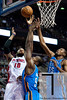 Nov 12, 2012; Auburn Hills, MI, USA; Detroit Pistons center Greg Monroe (10) puts up a shot over Oklahoma City Thunder power forward Serge Ibaka (9)during the fourth quarter at The Palace. Thunder won 92-90. Mandatory Credit: Tim Fuller-US PRESSWIRE