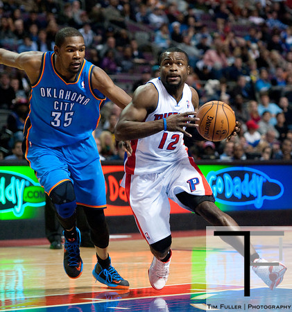Nov 12, 2012; Auburn Hills, MI, USA; Detroit Pistons point guard Will Bynum (12) drives to the basket against Oklahoma City Thunder small forward Kevin Durant (35) during the fourth quarter at The Palace. Thunder won 92-90. Mandatory Credit: Tim Fuller-US PRESSWIRE