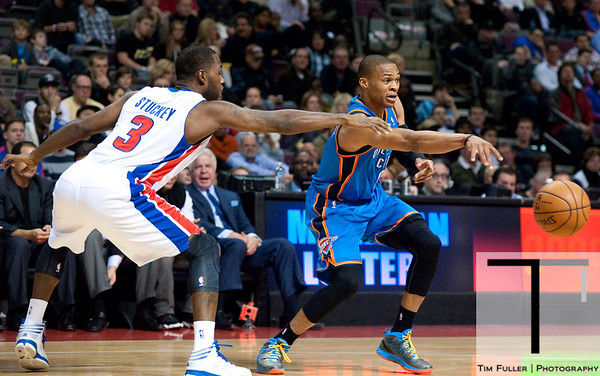 Nov 12, 2012; Auburn Hills, MI, USA; Oklahoma City Thunder point guard Russell Westbrook (0) passes the ball while being guarded by Detroit Pistons point guard Rodney Stuckey (3) during the second quarter at The Palace. Mandatory Credit: Tim Fuller-US PRESSWIRE
