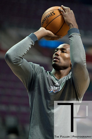 Nov 12, 2012; Auburn Hills, MI, USA; Oklahoma City Thunder power forward Serge Ibaka (9) warms up before the game against the Detroit Pistons at The Palace. Mandatory Credit: Tim Fuller-US PRESSWIRE
