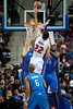 Nov 12, 2012; Auburn Hills, MI, USA; Detroit Pistons small forward Tayshaun Prince (22) puts up a shot over Oklahoma City Thunder power forward Nick Collison (left) and power forward Serge Ibaka (right) during the second quarter at The Palace. Mandatory Credit: Tim Fuller-US PRESSWIRE