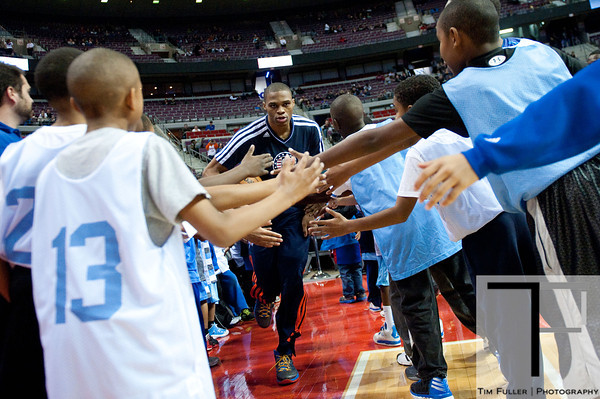 Nov 12, 2012; Auburn Hills, MI, USA; Oklahoma City Thunder point guard Russell Westbrook (0) high fives fans before the game against the Detroit Pistons at The Palace. Mandatory Credit: Tim Fuller-US PRESSWIRE