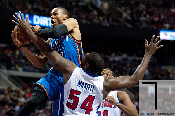 Nov 12, 2012; Auburn Hills, MI, USA; Oklahoma City Thunder point guard Russell Westbrook (0) goes to the basket against Detroit Pistons power forward Jason Maxiell (54) during the second quarter at The Palace. Mandatory Credit: Tim Fuller-US PRESSWIRE