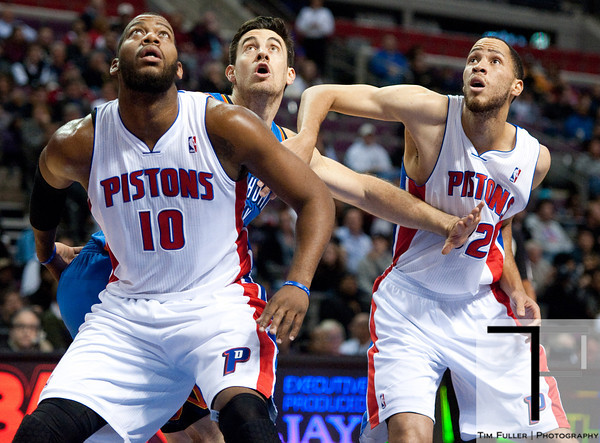 Nov 12, 2012; Auburn Hills, MI, USA; Detroit Pistons center Greg Monroe (10) and small forward Tayshaun Prince (22) battle for position with Oklahoma City Thunder power forward Nick Collison (4) during the first quarter at The Palace. Mandatory Credit: Tim Fuller-US PRESSWIRE