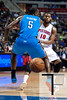Nov 12, 2012; Auburn Hills, MI, USA; Detroit Pistons center Greg Monroe (10) passes the ball around Oklahoma City Thunder center Kendrick Perkins (5)during the third quarter at The Palace. Thunder won 92-90. Mandatory Credit: Tim Fuller-US PRESSWIRE