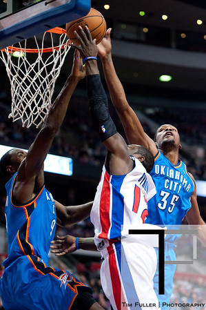 Nov 12, 2012; Auburn Hills, MI, USA; Oklahoma City Thunder small forward Kevin Durant (35) and power forward Serge Ibaka (9) attempt to block Detroit Pistons point guard Will Bynum (12) during the fourth quarter at The Palace. Thunder won 92-90. Mandatory Credit: Tim Fuller-US PRESSWIRE