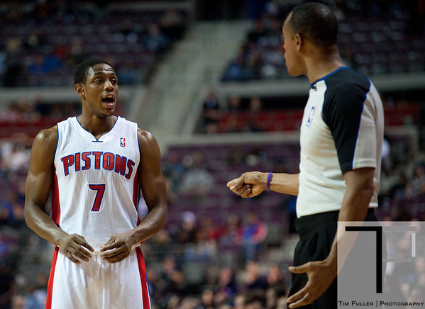Nov 12, 2012; Auburn Hills, MI, USA; Detroit Pistons point guard Brandon Knight (7) talks to NBA referee Rodney Mott (71) during the fourth quarter at The Palace. Thunder won 92-90. Mandatory Credit: Tim Fuller-US PRESSWIRE