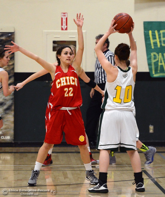 . Chico High\'s #22 Cia Seibert (left) defends against Paradise High\'s #10 Mary Hansen (right) in the first quarter of their girls basketball game at PHS Tuesday, February 18, 2014 in Paradise, Calif.  (Jason Halley/Chico Enterprise-Record)