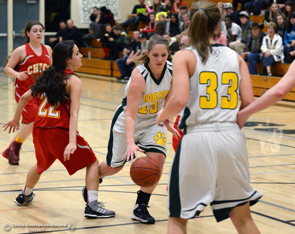 . Paradise High\'s #15 Bailey Bengson (right) dribbles against Chico High\'s #22 Cia Siebert (left) in the second quarter of their girls basketball game at PHS Tuesday, February 18, 2014 in Paradise, Calif.  (Jason Halley/Chico Enterprise-Record)
