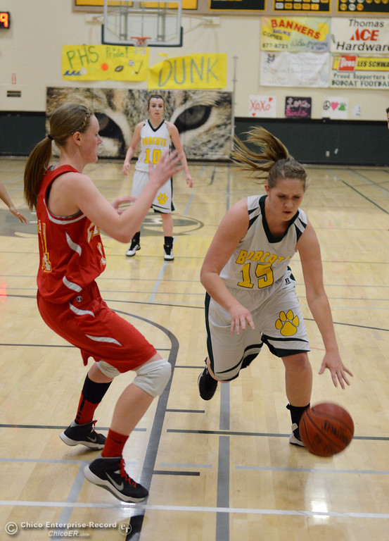 . Paradise High\'s #15 Bailey Bengson (right) dribbles against Chico High\'s #14 Lindsey Lundberg (left) in the second quarter of their girls basketball game at PHS Tuesday, February 18, 2014 in Paradise, Calif.  (Jason Halley/Chico Enterprise-Record)