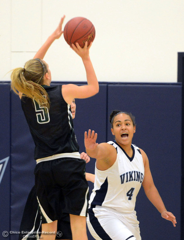 . Pleasant Valley High\'s #4 Dominique Jackson (right) defends against Colfax High\'s #5 Raegan Lillie (left) in the first quarter of their girls basketball game at PV\'s Varley Gym Saturday, December 7, 2013 in Chico, Calif. (Jason Halley/Chico Enterprise-Record)