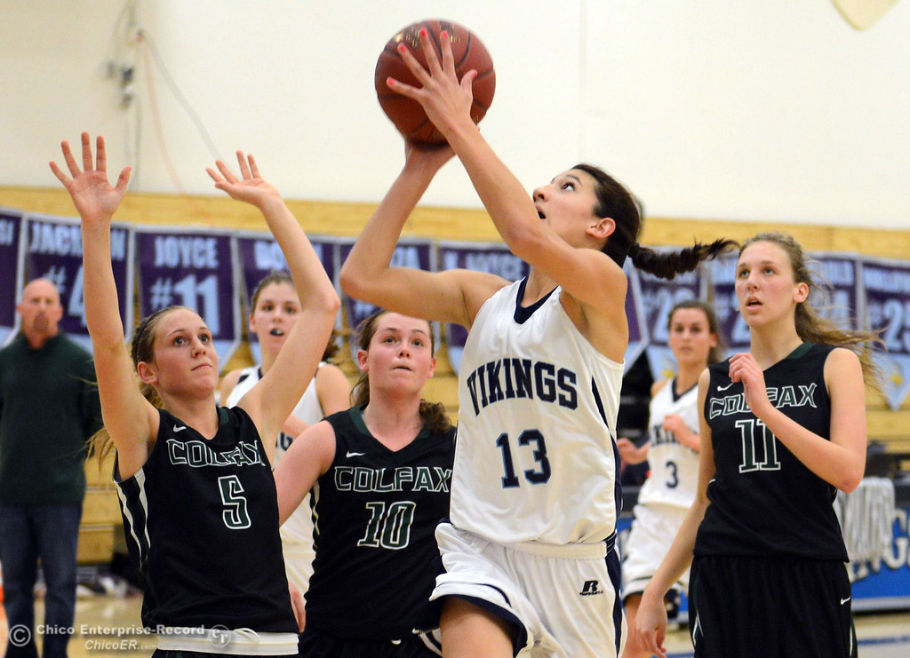 . Pleasant Valley High\'s #13 Brianna Souza (center) goes up for a shot against Colfax High\'s #5 Raegan Lillie, #10 Taylor Avila and #11 Kylee Bauer (left to right) in the second quarter of their girls basketball game at PV\'s Varley Gym Saturday, December 7, 2013 in Chico, Calif. (Jason Halley/Chico Enterprise-Record)