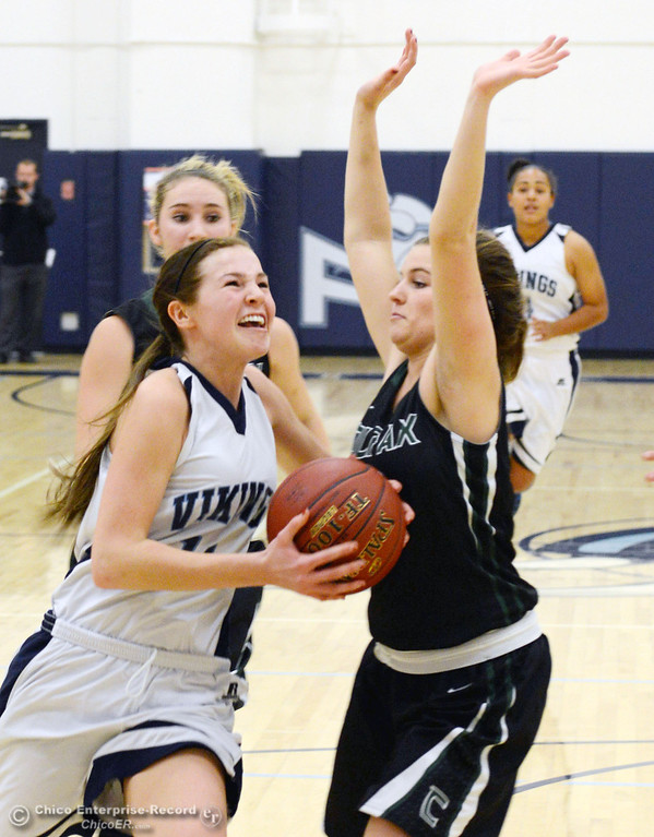 . Pleasant Valley High\'s #11 Kristina Joyce (left) drives to the basket against Colfax High\'s #13 Kylie Kirkland (right) in the first quarter of their girls basketball game at PV\'s Varley Gym Saturday, December 7, 2013 in Chico, Calif. (Jason Halley/Chico Enterprise-Record)