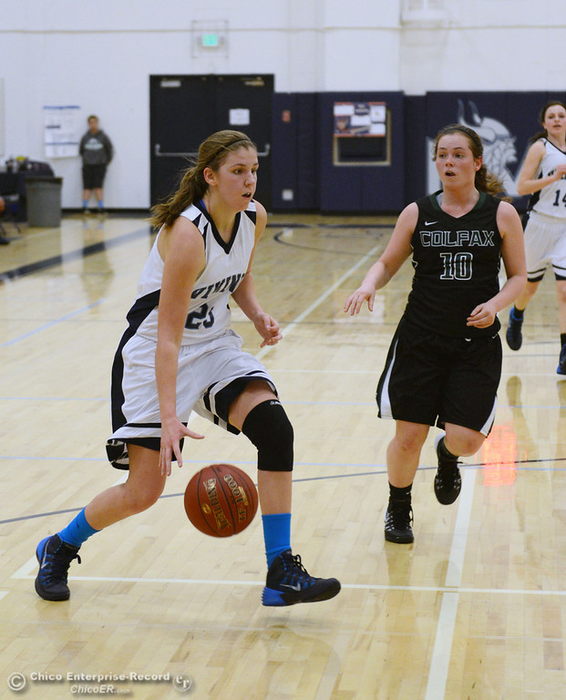 . Pleasant Valley High\'s #23 McKena Barker (left) dribbles against Colfax High\'s #10 Taylor Avila (right) in the second quarter of their girls basketball game at PV\'s Varley Gym Saturday, December 7, 2013 in Chico, Calif. (Jason Halley/Chico Enterprise-Record)