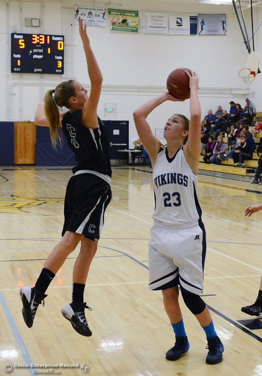 . Pleasant Valley High\'s #23 McKena Barker (right) takes a shot against Colfax High\'s #5 Raegan Lillie (left) in the first quarter of their girls basketball game at PV\'s Varley Gym Saturday, December 7, 2013 in Chico, Calif. (Jason Halley/Chico Enterprise-Record)