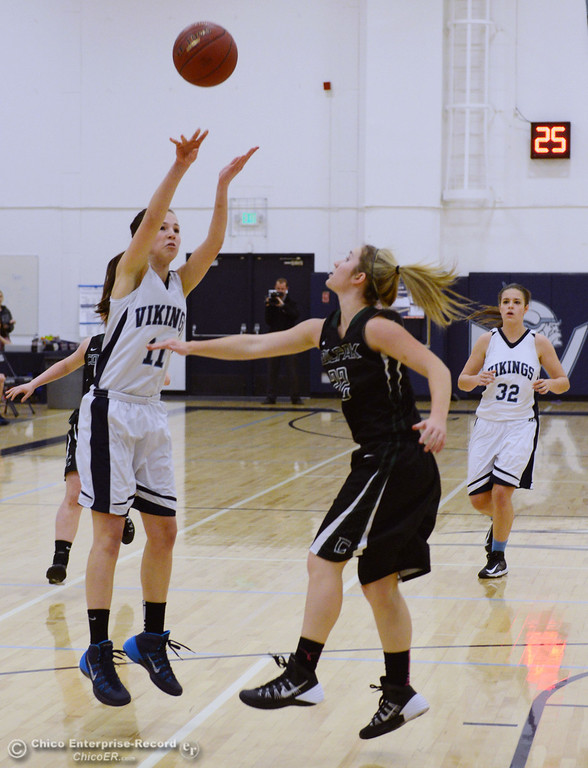 . Pleasant Valley High\'s #11 Kristina Joyce (left) takes a shot against Colfax High\'s #22 Lindsey Biles (right) in the first quarter of their girls basketball game at PV\'s Varley Gym Saturday, December 7, 2013 in Chico, Calif. (Jason Halley/Chico Enterprise-Record)