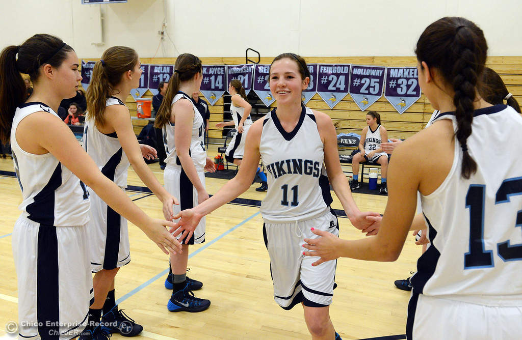 . Pleasant Valley High\'s #11 Kristina Joyce (center) is introduced against Colfax High in the first quarter of their girls basketball game at PV\'s Varley Gym Saturday, December 7, 2013 in Chico, Calif. (Jason Halley/Chico Enterprise-Record)
