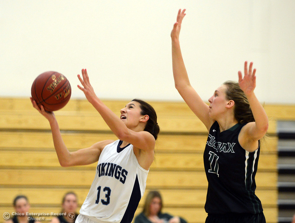 . Pleasant Valley High\'s #13 Brianna Souza (left) goes up for a shot against Colfax High\'s #11 Kylee Bauer (right) in the second quarter of their girls basketball game at PV\'s Varley Gym Saturday, December 7, 2013 in Chico, Calif. (Jason Halley/Chico Enterprise-Record)