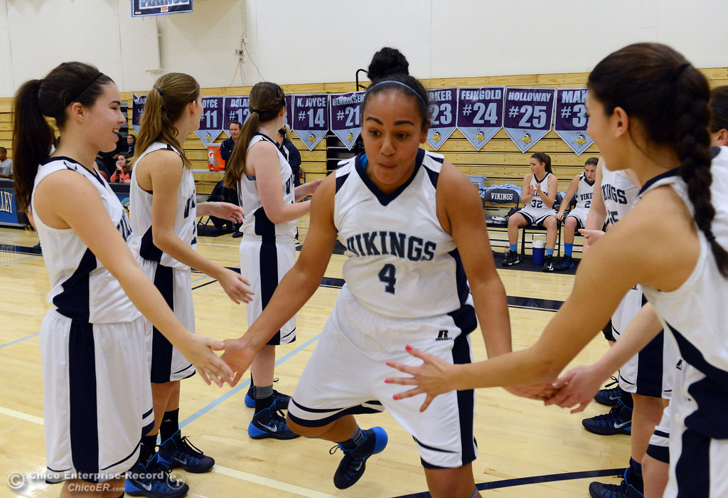 . Pleasant Valley High\'s #4 Dominique Jackson (center) is introduced against Colfax High in the first quarter of their girls basketball game at PV\'s Varley Gym Saturday, December 7, 2013 in Chico, Calif. (Jason Halley/Chico Enterprise-Record)