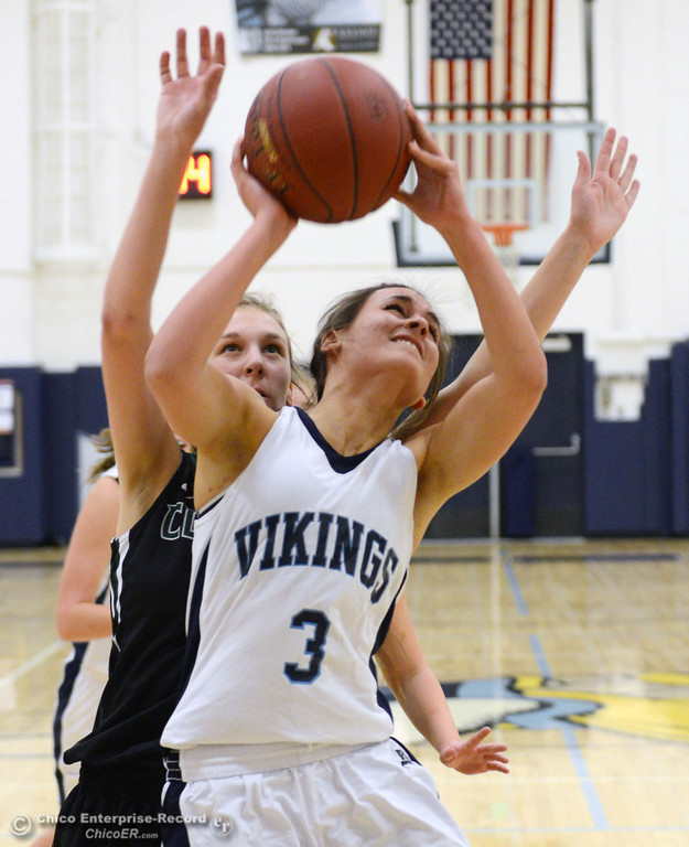 . Pleasant Valley High\'s #3 Izzy Bonacorsi (front) goes up for a shot against Colfax High\'s #11 Kylee Bauer (back) in the first quarter of their girls basketball game at PV\'s Varley Gym Saturday, December 7, 2013 in Chico, Calif. (Jason Halley/Chico Enterprise-Record)