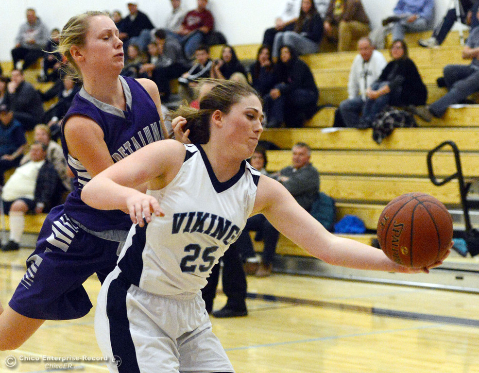 . Pleasant Valley High\'s #25 Courtney Holloway (right) rebounds against Petaluma High in the first quarter of their girls basketball game at PVHS Varley Gym Friday, December 6, 2013 in Chico, Calif. (Jason Halley/Chico Enterprise-Record)