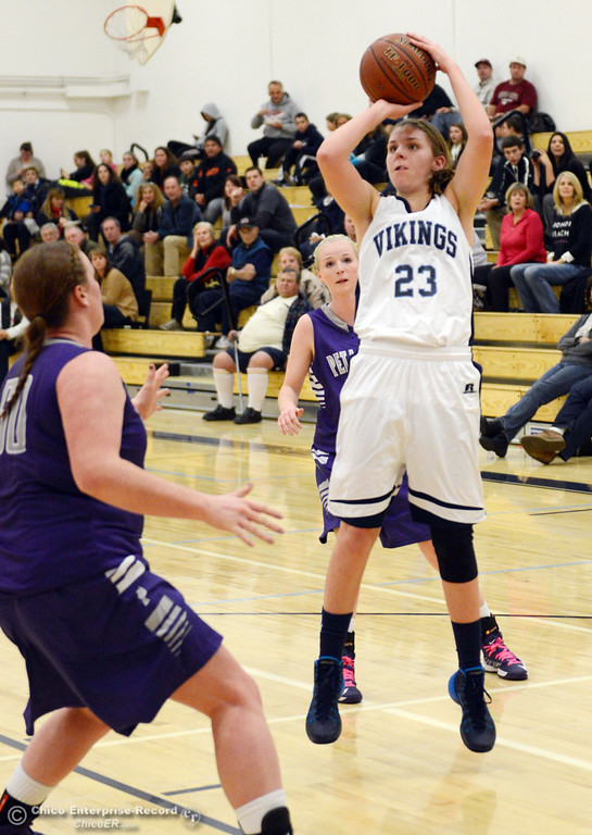 . Pleasant Valley High\'s #23 McKena Barker (right) takes a shot against Petaluma High in the first quarter of their girls basketball game at PVHS Varley Gym Friday, December 6, 2013 in Chico, Calif. (Jason Halley/Chico Enterprise-Record)