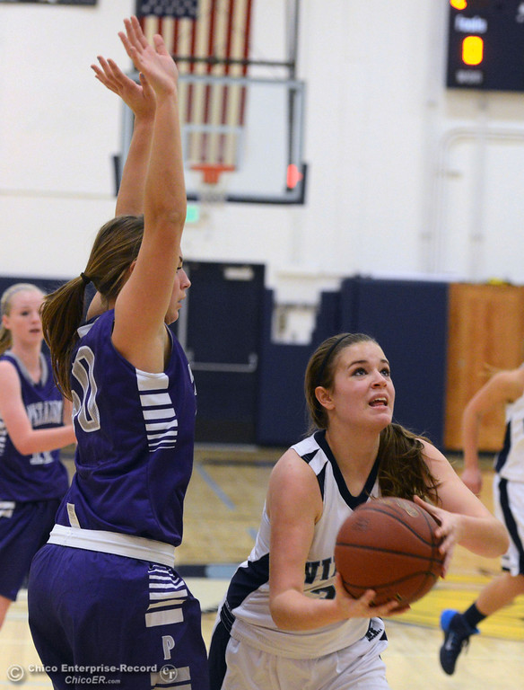 . Pleasant Valley High\'s #32 Natalie Makel (right) goes up for a basket against Petaluma High\'s #40 Joelle Krist (left) in the first quarter of their girls basketball game at PVHS Varley Gym Friday, December 6, 2013 in Chico, Calif. (Jason Halley/Chico Enterprise-Record)