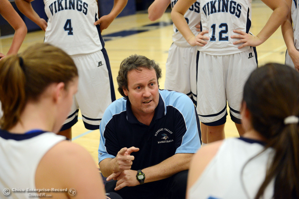 . Pleasant Valley High head coach Tony Carlisle talks to the team against Petaluma High in the first quarter of their girls basketball game at PVHS Varley Gym Friday, December 6, 2013 in Chico, Calif. (Jason Halley/Chico Enterprise-Record)